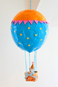 Children love getting their hands messy with paper mache and paint, and this easy peasy paper mache hot air balloon will allow them to do just that!