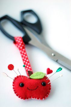 Tiny felt apple pincushion.