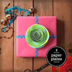 Day 2 of 12 Days of DIY Gift Wrapping!   Use a paper plate to make this cute topper!