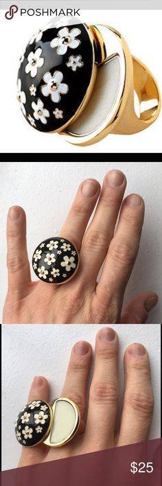 SOLD OUT Marc Jacobs Daisy Solid Fragrance Ring A playful Fragrance accessory with a vintage feel. A mod enamel, black Daisy ring twists to reveal the solid perfume inside. FRAGRANCE NOTES: grapefruit, violet leaves, strawberry, gardenia, jasmine, violet, wood, musk, vanilla. Marc Jacobs Jewelry Rings