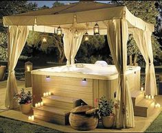 Outdoor hot tub with canopy and