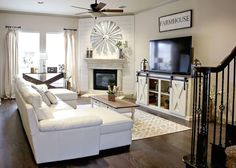 Rustic Farmhouse decor. Barndoor console table. Windmill mantlepiece. Shiplap fireplace.