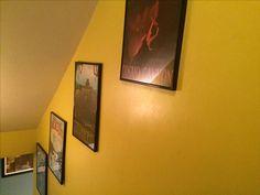 Geekyprints Final Fantasy travel poster series on stairway to game room