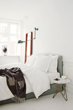 White bedroom with minimal décor
