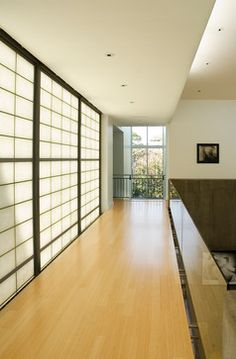 Translucent wall panels and glass half wall really open up this space for a light, airy feeling!