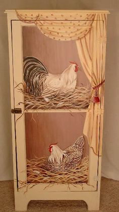 Hand painted Trompe l'oeil cabinet by artist Marsha Bowers of Zulim Bowers Designs. Rooster theme