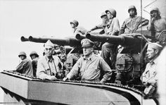 General Douglas MacArthur watching the bombardment of the Admiralty Islands with Vice Admiral Thomas Kinkaid (centre left), commander of US Naval forces in the operation. The islands were systematically attacked or isolated in preparation for the invasion of the Philippines.