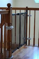Can you believe that this gate is hardware-mounted (a must for the top of the stairs), yet requires NO holes into the banister or spindles! Kids Gadgets, Baby Gates, Banisters, Childproofing, Classic House, Child Safety, Dark Wood, Cribs, New Homes