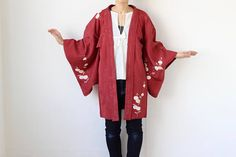 Description: Haori (羽織) an authentic kimono jacket with chrysanthemum floral motif. The background woven is plum blossom pattern. The lining is Japanese maple leaf pattern. an elegant jacket. You can wear it over a kimono or coordinate with your western clothing. Material: silk Size: approx. length 85 cm (33 inches) width 60 cm (24 inches) length <Sleeve> 51 cm (18 inches) width <Sleeve> 33 cm (13 inches)   Condition: very good -small light spots on back and lining *It has white s...