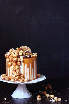 Cheesecake with a cascade of caramel popcorn and a caramel drizzle