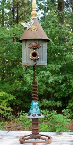 Found Object Bird House | This cool birdhouse was from a rusty funnel, an oil can, an insulator and spring, etc. Her husband welded it together from bits and pieces that were cluttering her barn.