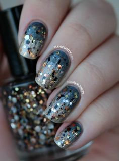 Use a gunmetal-colored polish for an update on the typical metallic hues. A coat of holographic glitter polish seals the deal. #newyears #nails