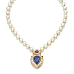 CULTURED PEARL, SAPPHIRE, RUBY AND DIAMOND NECKLACE Designed as a single row of cultured pearls, suspending a shield shaped pendant set with pear-shaped and oval sapphires, circular-cut rubies and brilliant-cut diamonds, the clasp set with a cabochon ruby, length approximately 405mm, French assay marks.