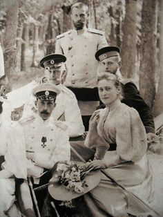 Grand Duke Sergei Alexandrovich (standing center) with his youngest brother Grand Duke Paul Alexandrovich (seated front left), Grand Duchess Elizabeth Feodorovna, and two unknown officers