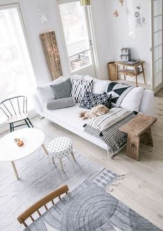 Even overtly rustic wood like these accents can transition beautifully into a Scandinavian design, it just takes the right styling. By incorporating the cool hues of black, white and grey, and utilising bold, modern patterns, the wooden decor functions to warm up a cool colour palette without being overbearing. Read more at: https://nyde.co.uk/blog/scandi-rooms-natural-wood-trend/