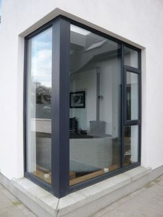 Fixed windows are stationary, non-opening UPVC windows intended to allow light into the room, offer an unobstructed view of outside and enhance the aesthetic of a home. It can also be paired with other window types to create a multi-utility system. Aluminium Windows And Doors, Upvc Windows, House Windows, Corner Windows, Bay Windows, Anthracite Grey Windows, Window Frame Colours, House Extensions, Window Design