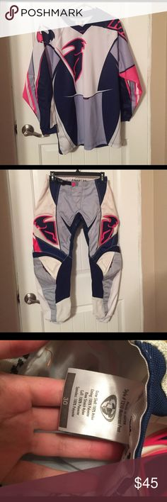 Thor motocross gear Thor motocross gear! Size women's small jersey, size 30 pants. Pink, navy blue, gray and white in color. Great protective gear for riding dirt bikes! Other