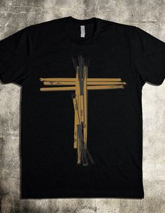 A worship band t-shirt that is simple and straightforward, but says a great deal about who you are. A black vintage t-shirt featuring drum sticks arranged in a cross. A clear visual whether you're a drummer in the worship band, or simply a Christ Follower that loves music, this shirt is designed especially for you.