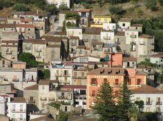 The harsh summer sun over the homes at Sinagra, Messina. Sicily. https://sicilyinsideandout.com/