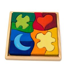 Wooden Puzzle Shaped by Grimm's.
