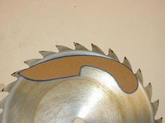 Making a knife from a 10 inch table saw blade -  makes an excellent double bladed axe as well , have made a couple of them