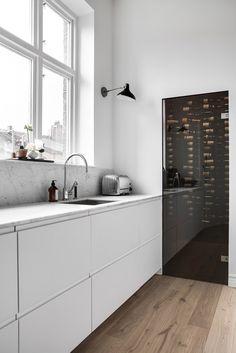 Cute white gloss cabinets marble backsplash black wall mounted light built in wine fridge