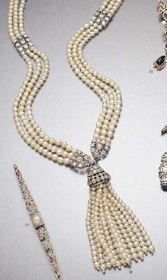 Platinum, pearl and diamond sautoir, circa 1925. The necklace composed of three rows of fine pearls interspersed with openwork sections set wtih diamonds, mounted in platinum, suspending a removable tassel with a platinum cap set with diamonds.