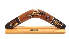 Boomerang ~ Fashioned from the native Acacia tree and handpainted by Aboriginal artists in Australia....