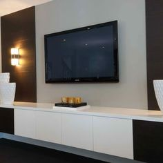 TV Wall Design, kinda like this, add a long floating Shelf above tv and a sliding picture to cover tv when not in use
