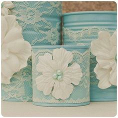 I like this tin cans and lace flowers very delicate and feminine.
