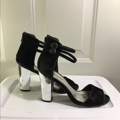 Black strapped chunky metallic heel Fairly worn✨ as seen in picture ✨ very gorgeous heel✨ any questions please leave me a comment please use the offer button  I accept all reasonable ones  Shoes Heels