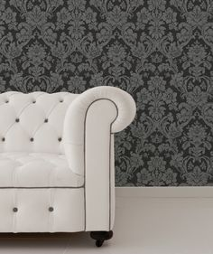 This is a modern style sofa yet it blends perfectly with the black floral damask wallpaper to create a classical feel fit for royalty