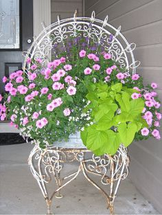 Rescued Chair for pretty flowers. I think I could use one of my many plastic chairs paint a large sunflower or other flowers. Then I'll spray it with clear outdoor rustoleum spray. Put a plastic pot on it. Then plant it with some climbers and geraniums. Flower Planters, Garden Planters, Garden Art, Flower Pots, Garden Design, Flower Containers, Diy Planters, Chair Planter, Ideas Hogar
