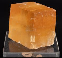 Cubic Optical Calcite Iceland Spar orange crystal specimenMaterial: calciteWeight: 81 grams / 2.85 oz (weight of stone 67 gr)Size: 31.8*34*23 mmOrigin:  ChinaThe item in our pictures is exactly the stone you will receiveThis crystal is in its raw/ rough natural geometric crystal form. It has not been cut, color treated, or enhanced in any way. Orange Crystals, Natural Crystals, Stones And Crystals, Crystal Sphere, Iceland, China, Treats, Pictures, Etsy