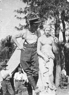 An Australian soldier posing with a statue of Venus in Egypt during World War I. PRG 280/1/27/75.