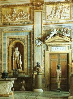 The statue of Dionysos holding the thyrsos and the Herm of Dionysos in the Room of the Emperors, Galleria Borghese, Roma