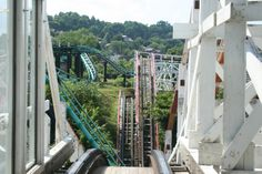 Thunderbolt at Kennywood, West Mifflin, Pennsylvania, a terrain wooden coaster built into the park's natural ravine, originally built by John A. Miller in 1924; here's a view of the first drop right out of the station; the ride remains the most popular at Kennywood
