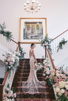 Still swooning over Rachel's beautiful Bali wedding? We're back with more of her red carpet-worthy style including a third wedding gown by Atelier Pronovias from Truly Enamoured which she wore for her dinner reception at InterContinental Singapore. And don't get us started on those staircase shots by Nicolethen Studio with lush blush and white flower arrangements by Floral Magic decorating the banisters. *heart eyes emoji*