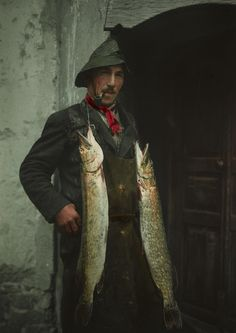 A Swiss fisherman poses with his catch. PHOTOGRAPH BY HANS HILDENBRAND