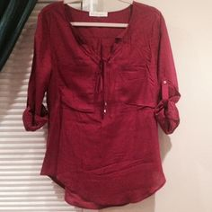 Tunic top Burgundy top. Roll up sleeves. V-neck with strings. 2 front pockets. Brand new, never worn.  Please use offer button to negotiate. Reasonable offers considered.   NO TRADES  love tree happens Tops Tunics