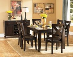 Crown Point 7Pcs Dining Set 1372(Dining Table,6 Side Chairs)Adorn your dining area with Crown Point Collection. This grand scale casual dining in warm merlot finish is as strong and durable as they are stunning. Table top is constructed of mango veneer with strong support tapered legs. Attractive X-back dining chair with comfortable leather-look dark brown seat completes the unsophisticated streamlined look.Features:Butterfly Leaf TableCrown Point CollectionMerlot Finish Dimensions:Dining…