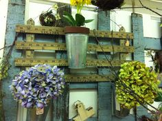 Adorable planter holder made from yardsticks! www.OldTownVillageAntiques.com
