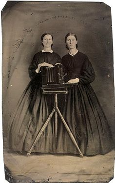 ca. 1860-70's, [tintype portrait of two women posed with a camera box] via Cowan's Auctions