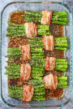 These asparagus bundles wrapped in crisp-tender bacon in a buttery brown sugar glaze were a huge hit last night!