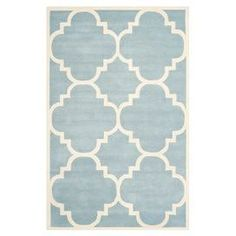 Hand-tufted wool rug with a quatrefoil motif.  Product: RugConstruction Material: WoolColor: Blue and ivoryFeatures:  Made in IndiaHand-tufted Note: Please be aware that actual colors may vary from those shown on your screen. Accent rugs may also not show the entire pattern that the corresponding area rugs have.Cleaning and Care: Professional cleaning recommended