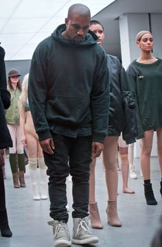 Kanye West appears with models during the showing of the Kanye West Adidas Fall 2015 collection at Fashion Week.