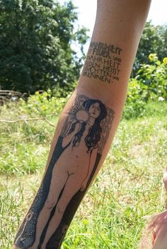 Black ink klimt forearm tattoo