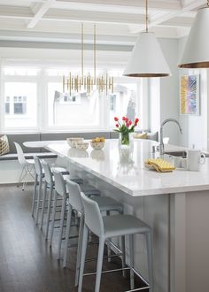 Beautiful color palette of Grey, white and gold in this kitchen!