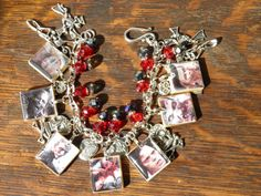 "OOAK Hand Crafted Zombie Apocalypse Loaded Charm Bracelet Walking Dead,  Romero, Pewter Charms, Swarovski Crystals Reversible to Spell ""ZOMBIES"" by MelancholyMind, on Etsy"