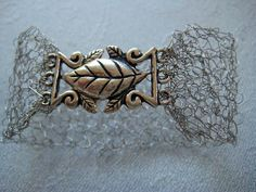 Knitted wire jewelry -A Cuff bracelet with knitted silver wire- lacy romantic couture boutique style- trendy one of a kind.